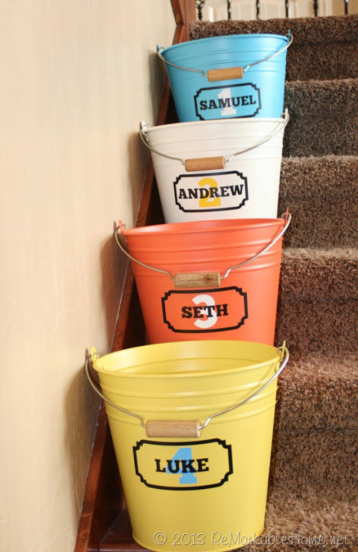 buckets on the stairs with names
