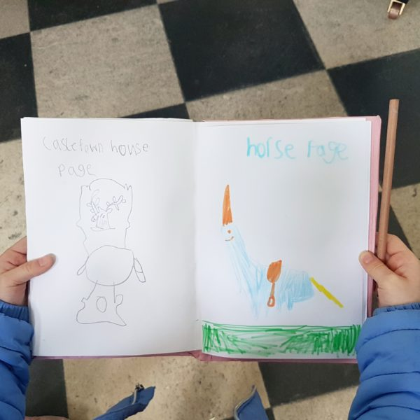 writing in our notebooks at easter camp in Castletown house