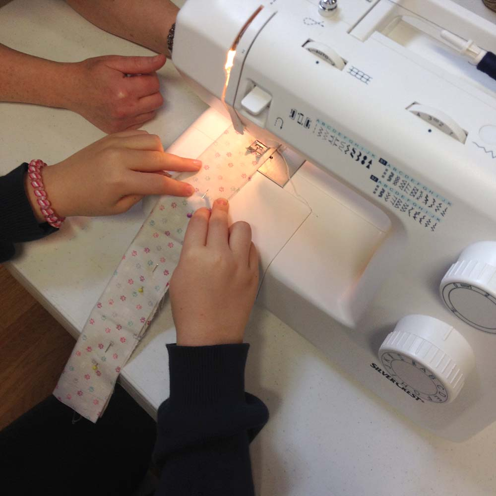 teaching children how to sew in our machine sewing classes
